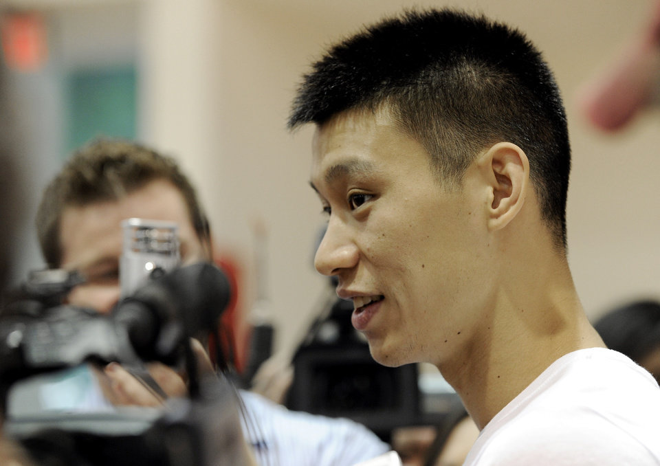 Photo -   Houston Rockets' Jeremy Lin speaks with the media after NBA basketball practice, Tuesday, Sept. 18, 2012, in Houston. (AP Photo/Pat Sullivan)