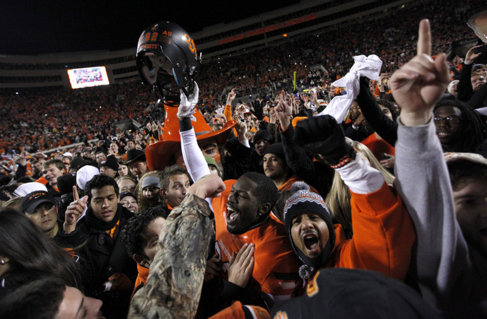 Photo - Oklahoma State's Isaiah Anderson (82) celebrates with fans following during the Bedlam college football game between the Oklahoma State University Cowboys (OSU) and the University of Oklahoma Sooners (OU) at Boone Pickens Stadium in Stillwater, Okla., Saturday, Dec. 3, 2011. OSU won 44-10. Photo by Sarah Phipps, The Oklahoman