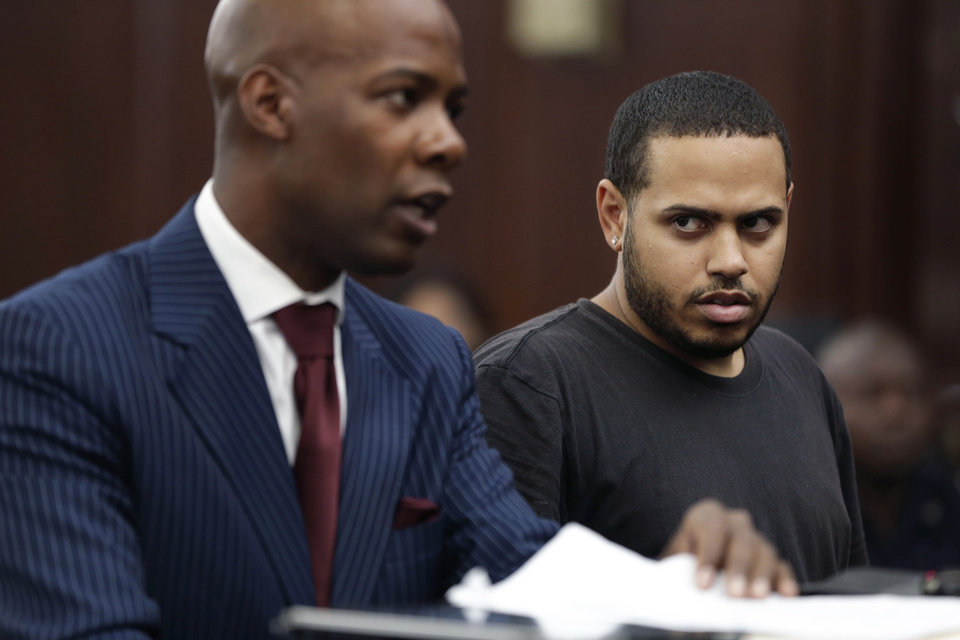 Photo - Christopher Cruz, right, appears in criminal court with his lawyer H. Benjamin Perez in New York, Wednesday, Oct. 2, 2013.  Cruz, 28, of New Jersey, was charged Wednesday with reckless driving after prosecutors said he touched off a tense encounter with the driver of a sport utility vehicle and a throng of other bikers that ended with blood and broken bones on a Manhattan street. He was also charged with unlawful imprisonment. His bail was set at $1,500 cash.  (AP Photo/Seth Wenig)