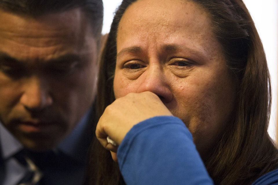 Photo - Betzaida Jimenez, mother of 33-year-old Sarai Sierra who was found dead on Saturday in Turkey, pauses during a news conference at a friend's home in Staten Island, Monday, Feb. 4, 2013, in New York. Sierra went missing while vacationing alone in Istanbul on Jan. 21, the day she was due to board her flight back home.   Congressman Michael Grimm is at left. (AP Photo/John Minchillo)