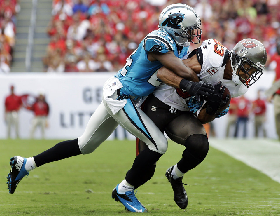 Photo -   Tampa Bay Buccaneers wide receiver Vincent Jackson (83) is tackled by Carolina Panthers cornerback Josh Norman (24) after a reception during the second quarter of an NFL football game, Sunday, Sept. 9, 2012, in Tampa, Fla. (AP Photo/Margaret Bowles)
