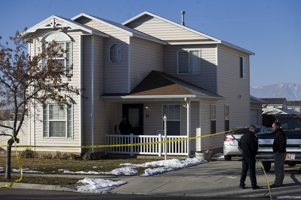 Photo - Investigators put police tape in front of a home, Friday, Jan. 17, 2014, in Spanish Fork, Utah, where five people were found dead on Thursday.  A 34-year-old officer shot and killed his wife, mother-in-law and two young children and turned the gun on himself, authorities said Friday.  Spanish Fork police said the five were found dead about 11 p.m. Thursday, when co-workers reported Joshua Boren didn't show up for his night shift as a patrol officer at the Lindon Police Department. (AP Photo/Daily Herald, Mark Johnston)