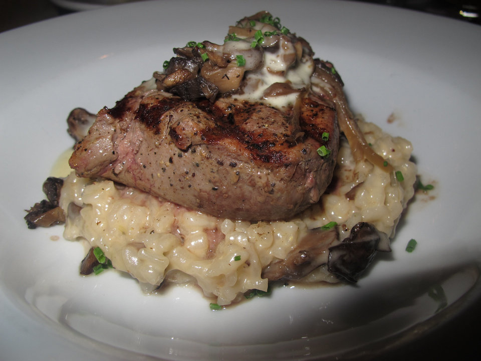 The filet mignon served atop wild mushroom risotto and white truffle-herb butter sauce is a signature dish at Le Cellier Steakhouse in Disney's Epcot theme park. Disney World has more than 100 restaurants on its property. <strong>Richard Hall</strong>