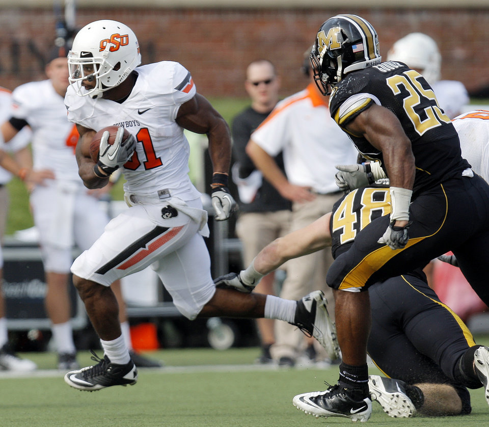 Photo - Oklahoma State's Jeremy Smith (31) runs from Missouri's Andrew Wilson (48) and Zaviar Gooden (25) during a college football game between the Oklahoma State University Cowboys (OSU) and the University of Missouri Tigers (Mizzou) at Faurot Field in Columbia, Mo.,  OSU won, 45-24. Saturday, Oct. 22, 2011. Photo by Nate Billings, The Oklahoman ORG XMIT: KOD