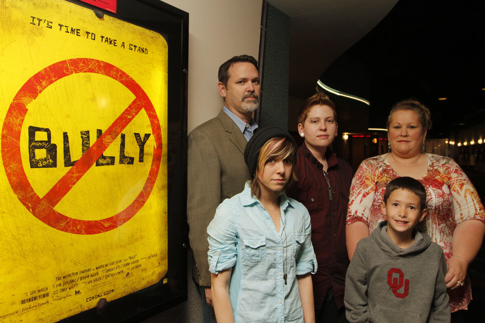 "Kelby Johnson (center), 19, poses for a photo with her family (from left) Bobby, father, Tyler Woods, 20, girlfriend, Mayne Fowler, 8, and Londa, mom, before a screening of the documentary ""Bully"" at Quail Springs AMC Theatre in Oklahoma City, Monday, April 9, 2012.  Photo by Garett Fisbeck, For The Oklahoman"