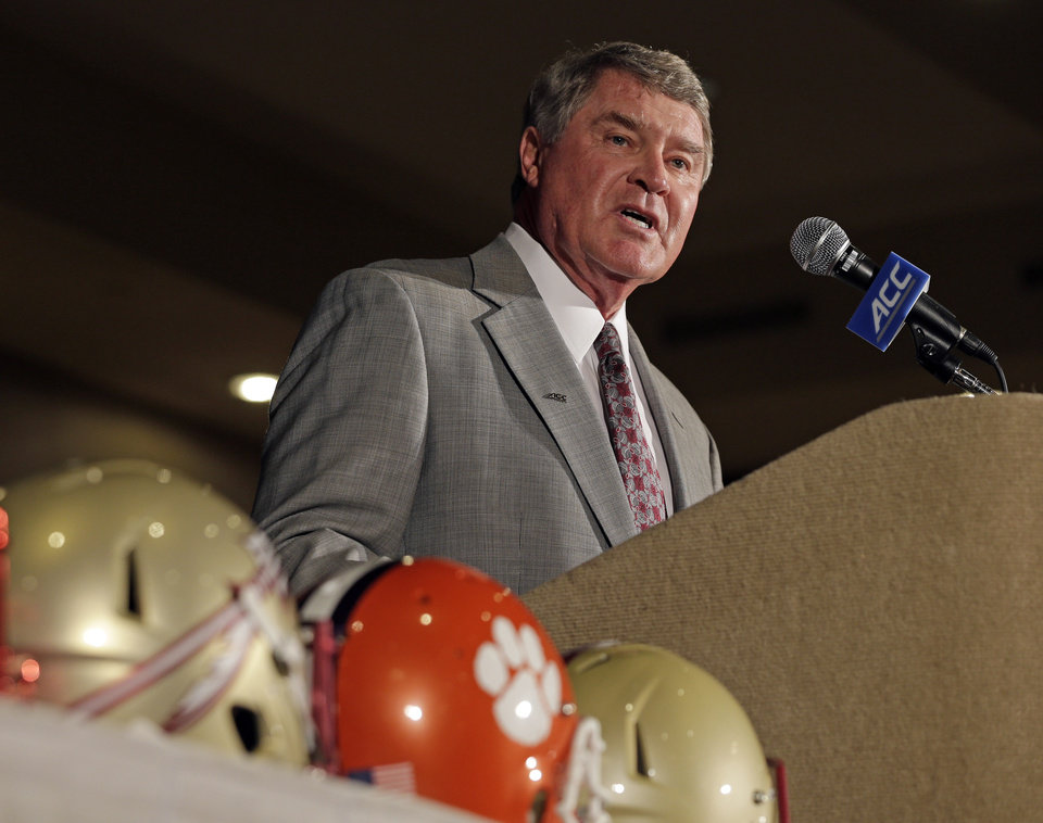 Photo - Atlantic Coast Conference commissioner John Swofford speaks during a news conference at the Atlantic Coast Conference Football kickoff in Greensboro, N.C., Sunday, July 20, 2014. (AP Photo/Chuck Burton)