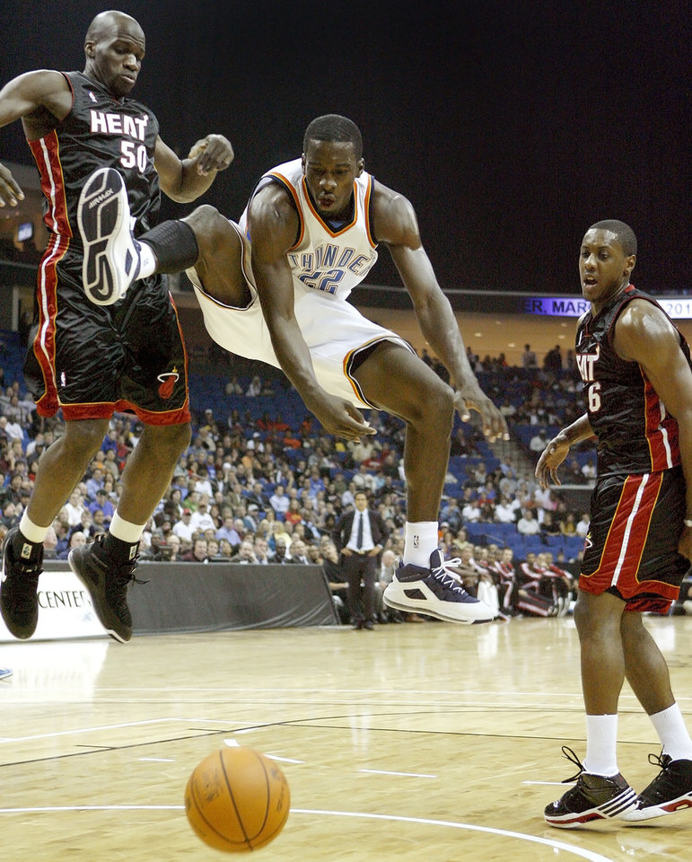 Oklahoma City's Jeff Green loses control of the ball after a foul between Miami's Joel Anthony, left, and Mario Chalmers during an NBA preseason game between the Oklahoma City Thunder and the Miami Heat at the BOK Center in Tulsa, Okla., Wednesday, October 14, 2009. Photo by Bryan Terry, The Oklahoman