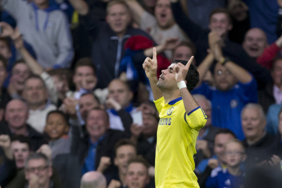 Photo - Chelsea's Diego Costa celebrates after scoring his second goal against Everton during their English Premier League soccer match at Goodison Park Stadium, Liverpool, England, Saturday Aug. 30, 2014. (AP Photo/Jon Super)