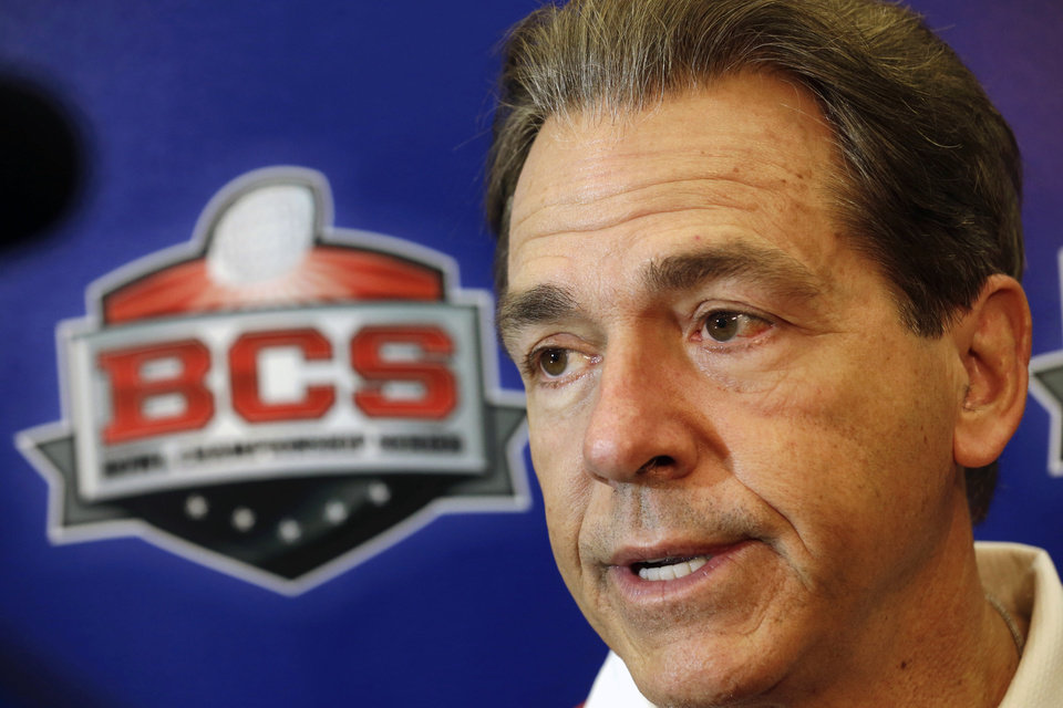 Alabama head coach Nick Saban talks to reporters after practice for the Jan. 2 Sugar Bowl NCAA college football game against Oklahoma, in New Orleans on Saturday, Dec. 28, 2013. (AP Photo/Gerald Herbert)