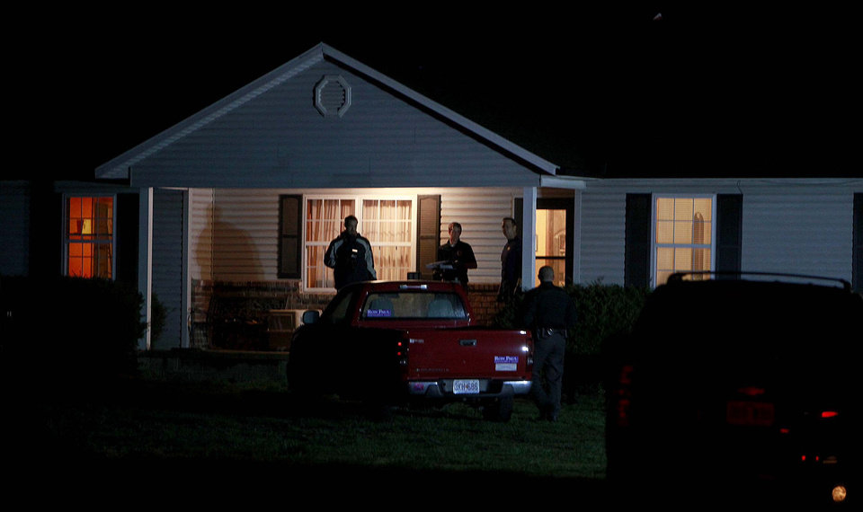 Photo - Members of the ATF and FBI search a house belonging to Fraiser Glenn Cross, also known as Frazier Glenn Miller, near Marionville, Mo., The Lawrence County Mo. sheriff and Missouri State Highway Patrol are also on the scene. (AP Photo/Springfield News-Leader, Nathan Papes)