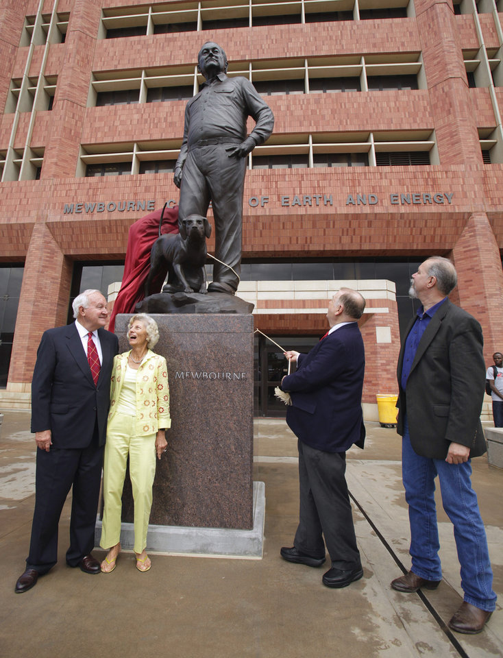 University of Oklahoma president David Boren pulls the cord to unveil a bronze sculpture of Curtis Mewbourne (left with wife Joanne), for whom the University of Oklahoma Mewbourne College of Earth and Energy is named on Wednesday Sept. 1, 2010, in Norman, Okla.  At righ is sculptor Paul Moore.  Photo by Steve Sisney, The Oklahoman
