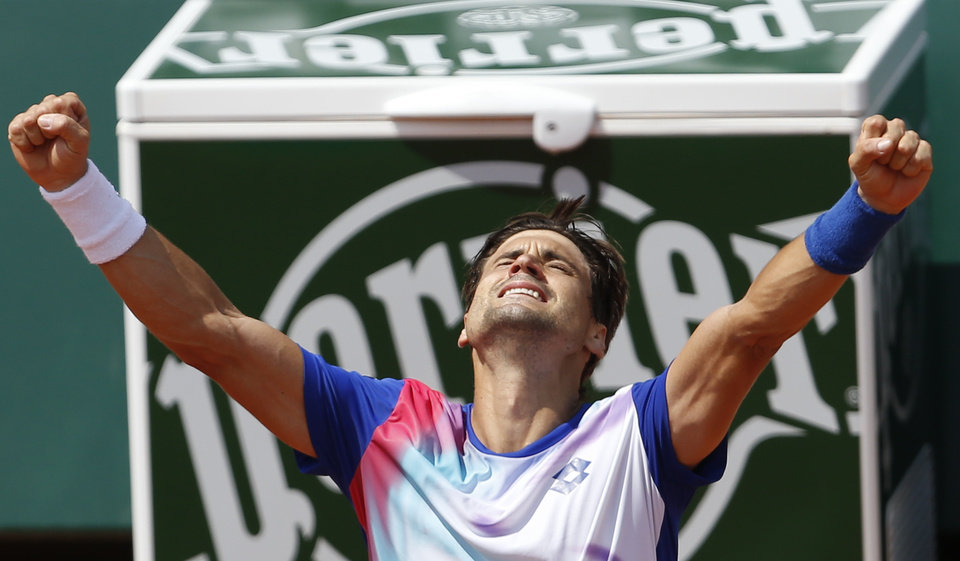 Photo - Spain's David Ferrer celebrates winning his third round match of the French Open tennis tournament against Italy's Andreas Seppi at the Roland Garros stadium, in Paris, France, Saturday, May 31, 2014. (AP Photo/Darko Vojinovic)