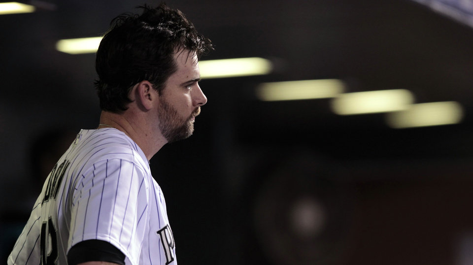 Photo - Colorado Rockies relief pitcher Boone Logan (48) stands in the dugout in the 12th inning of a baseball game after he gave up the go-ahead home run to Chicago Cubs' Javier Baer in Denver on Tuesday, Aug. 5, 2014. Chicago won 6-5. (AP Photo/Joe Mahoney)