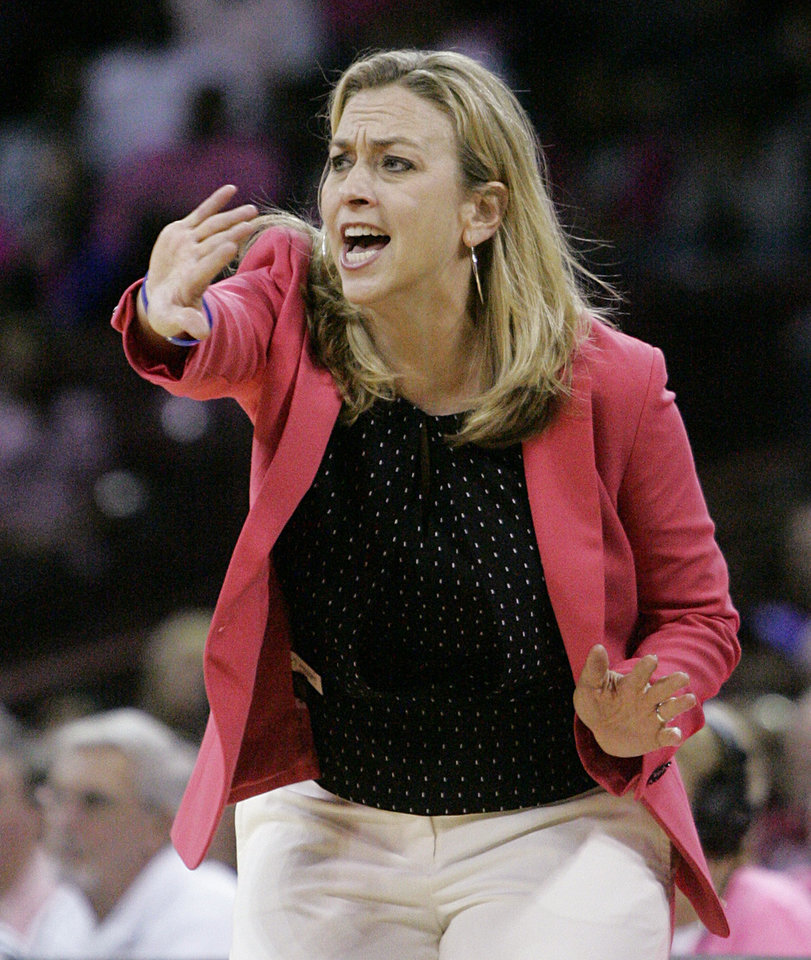 Photo - Florida's Amanda Butler talks to her players during the first half of an NCAA college basketball game against South Carolina, Sunday, Feb. 23, 2014, in Columbia, SC. South Carolina defeated Florida 69-55. (AP Photo/Mary Ann Chastain)