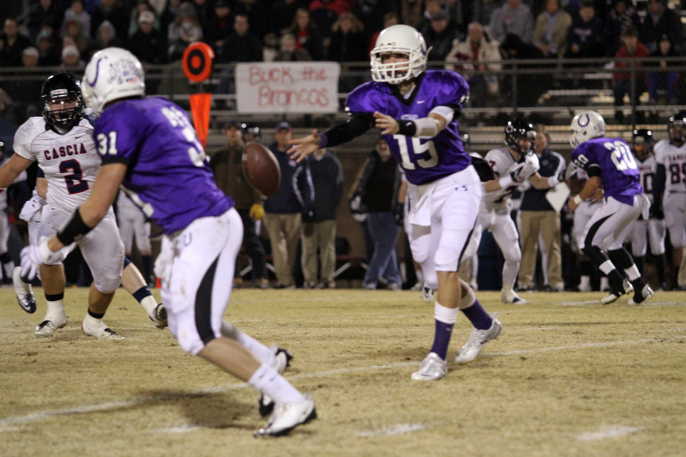 Photo - Bethany quarterback Ryley Clabom pitches the ball to Brett Gilstrap during the Class 3A quarterfinals between Bethany and Cascia Hall in Bethany, Friday, November 25, 2011. PHOTO BY HUGH SCOTT, FOR THE OKLAHOMAN