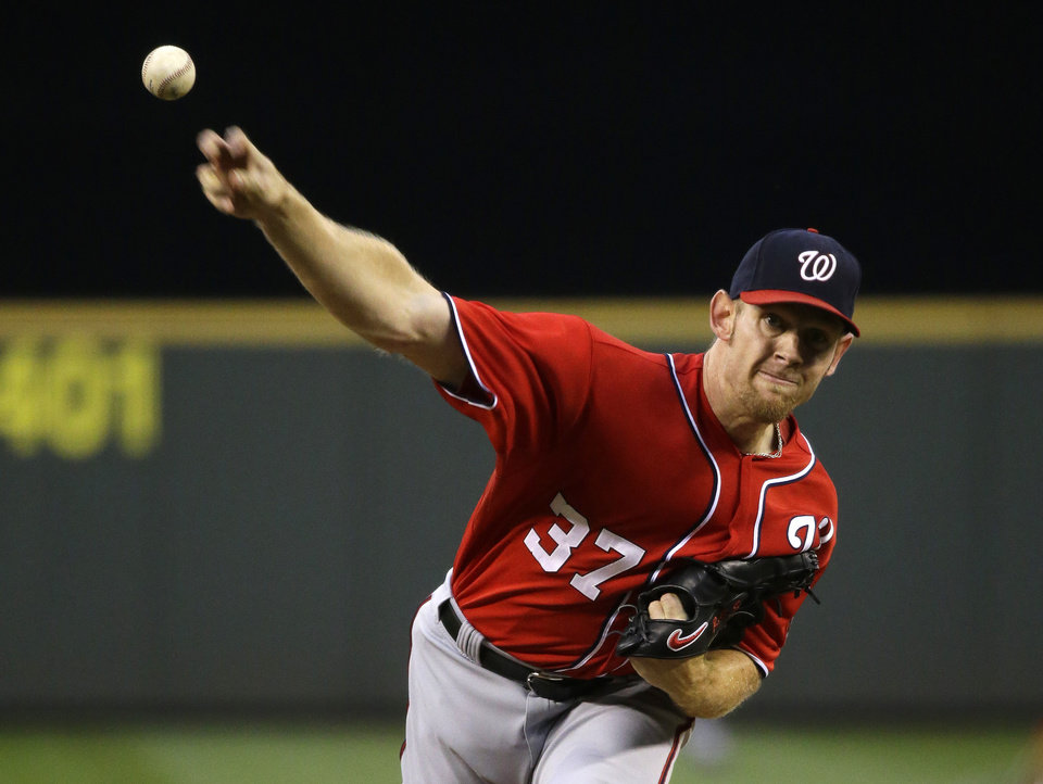 Photo - Washington Nationals starting pitcher Stephen Strasburg throws against the Seattle Mariners in the fourth inning of a baseball game, Saturday, Aug. 30, 2014, in Seattle. (AP Photo/Ted S. Warren)