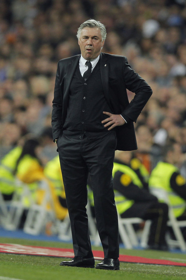 Photo - Real's coach Carlo Ancelotti watches the Spanish La Liga soccer match between Real Madrid and Levante at the Santiago Bernabeu stadium in Madrid, Spain, Sunday, March 9, 2014. (AP Photo/Andres Kudacki)