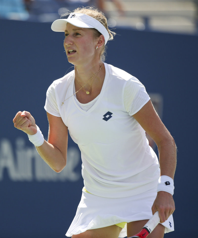 Photo - Ekaterina Makarova, of Russia, reacts after a shot against Victoria Azarenka, of Belarus, during the quarterfinals of the 2014 U.S. Open tennis tournament, Wednesday, Sept. 3, 2014, in New York. (AP Photo/Mike Groll)