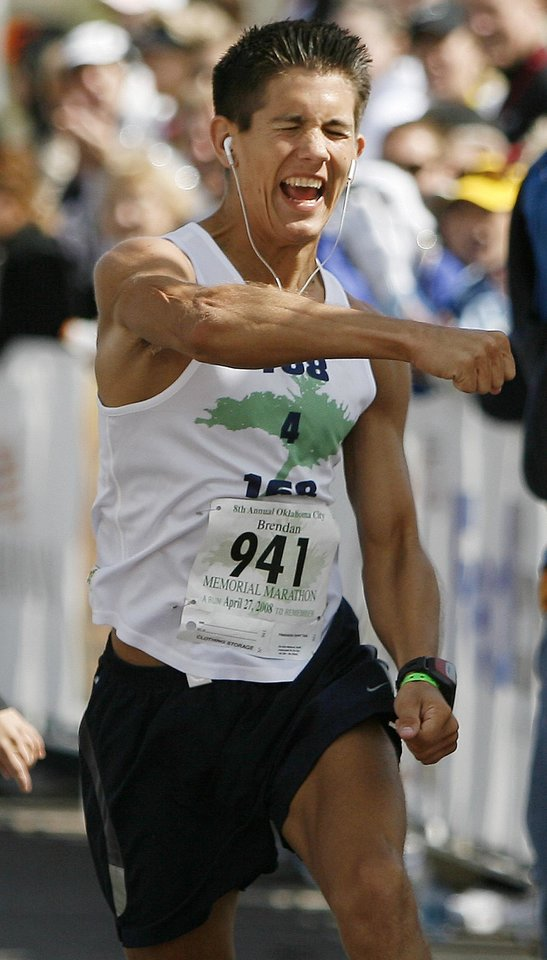 Photo - RUN, RUNNER, RUNNING: Brendan Brustad finishes the Oklahoma City Memorial Marathon, Sunday, April 27, 2008. Brustad ran a total 168 miles including the marathon to honor those killed in the Oklahoma City bombing. BY BRYAN TERRY, THE OKLAHOMAN ORG XMIT: KOD