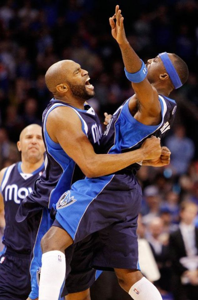 Vince Carter (25) and Jason Terry (31), right, of Dallas celebrate a shot by Carter with 1.4 seconds left to give the Mavericks a 102-101 lead in the fourth quarter of an NBA basketball game between the Oklahoma City Thunder and the Dallas Mavericks at Chesapeake Energy Arena in Oklahoma City, Thursday, Dec. 29, 2011. Kevin Durant hit a shot as time expired to give Oklahoma City a 104-102 win. In the background is Jason Kidd. Photo by Nate Billings, The Oklahoman