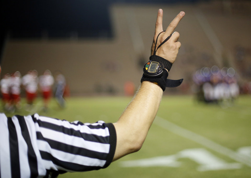 A referee signals second down for NWC at the Northwest Classen vs. Western Heights high school football game at Taft Stadium Thursday, September 20, 2012. Photo by Doug Hoke, The Oklahoman