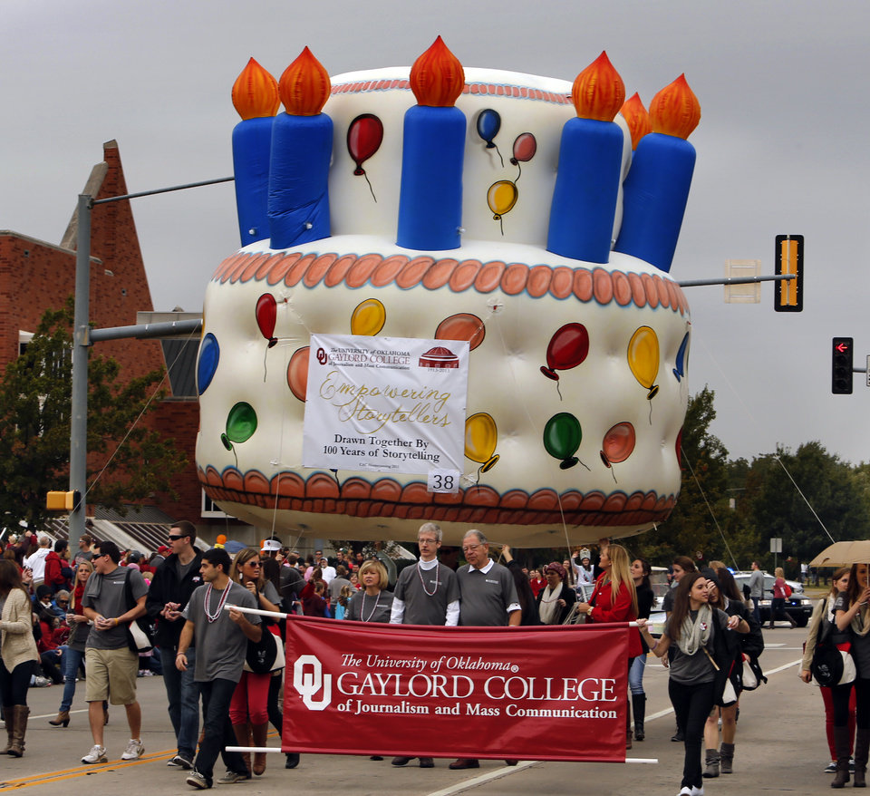 The Gaylord College of Journalism enters a helium filled birthday cake in the Homecoming Parade before the  college football game between the University of Oklahoma Sooners (OU) and the Texas Tech Red Raiders at Gaylord Family-Oklahoma Memorial Stadium in Norman, Okla., on Saturday, Oct. 26, 2013. Photo by Steve Sisney, The Oklahoman