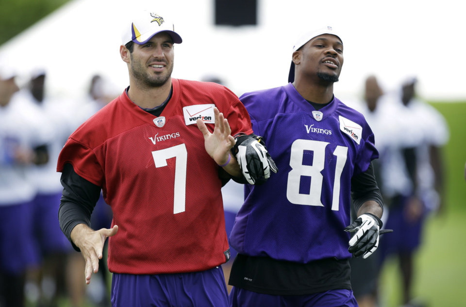 Photo - Minnesota Vikings quarterback Christian Ponder (7) runs off the field with wide receiver Jerome Simpson following practice at NFL football training camp, Friday, July 26, 2013, in Mankato, Minn. (AP Photo/Charlie Neibergall)