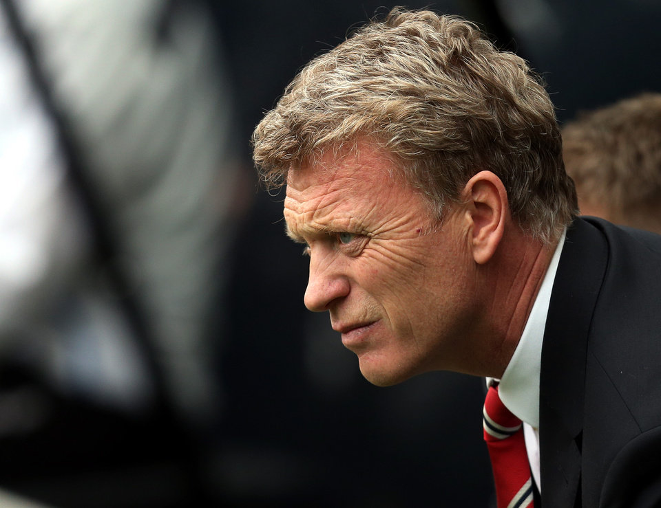 Photo - Manchester United's manager David Moyes looks on ahead of their English Premier League soccer match against Newcastle United at St James' Park, Newcastle, England, Saturday, April 5, 2014. (AP Photo/Scott Heppell)