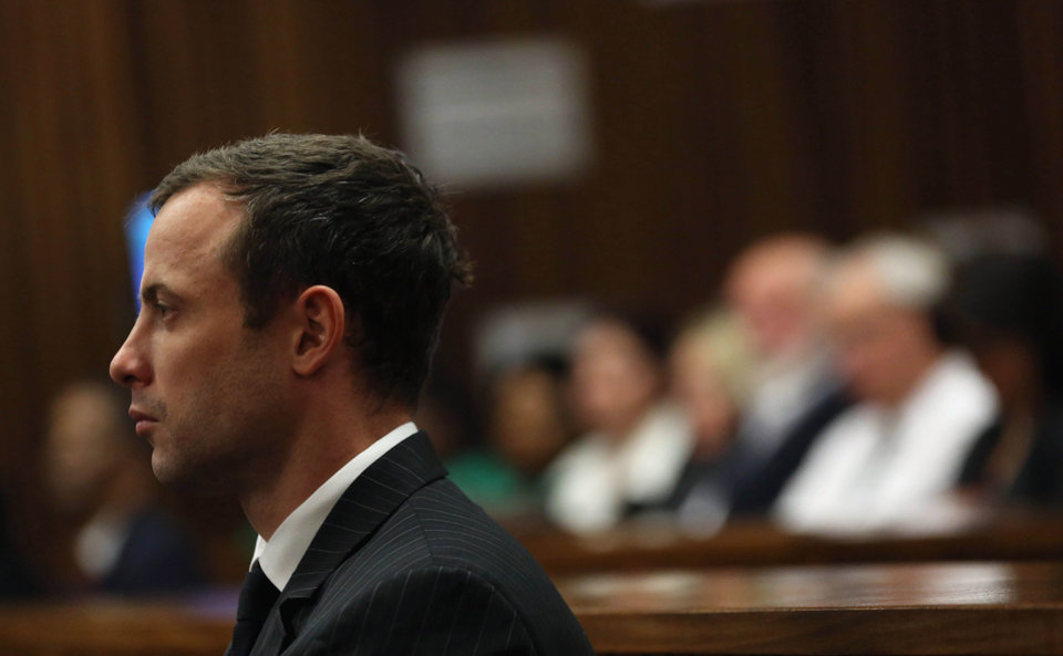 Photo - Oscar Pistorius, pauses in court, during his trial, in Pretoria, South Africa, Friday, Aug. 8, 2014. The chief defense lawyer for Oscar Pistorius delivered final arguments in the athlete's murder trial on Friday, alleging that Pistorius thought he was in danger when he killed girlfriend Reeva Steenkamp and also that police mishandled evidence at the house where the shooting happened.    (AP Photo/Themba Hadebe, Pool)