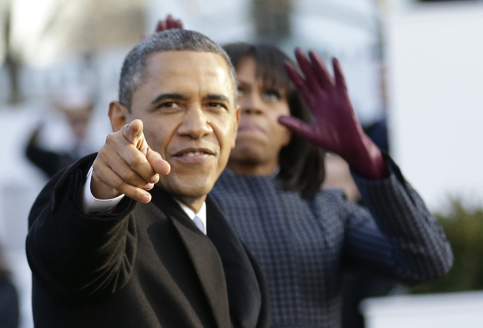 Photo - walk down Pennsylvania Avenue en route to the White House, Monday, Jan. 21, 2013, in Washington. Thousands  marched during the 57th Presidential Inauguration parade after the ceremonial swearing-in of President Barack Obama. (AP Photo/Frank Franklin II)