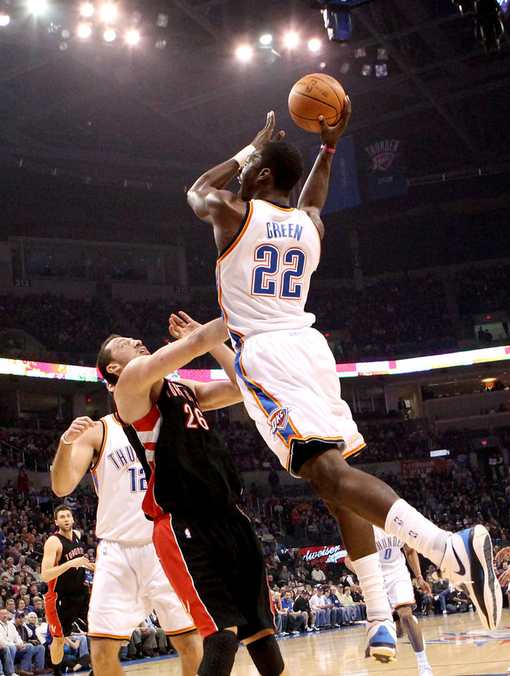Photo - Oklahoma City's Jeff Green puts a shot over Toronto's Hedo Turkoglu during their NBA basketball game at the Ford Center in Oklahoma City on Sunday, Feb. 28, 2010. Photo by John Clanton, The Oklahoman