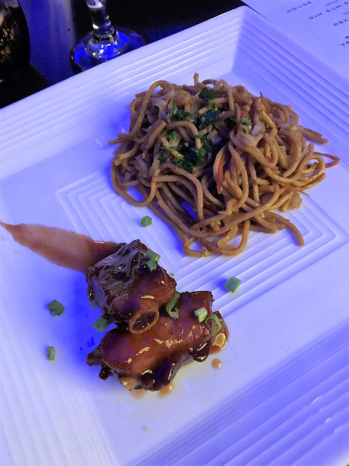 Photo -  This is braised spare rib and Asian pan noodles served during a special event at Kwan's Kitchen. [Photo by Dave Cathey, The Oklahoman]