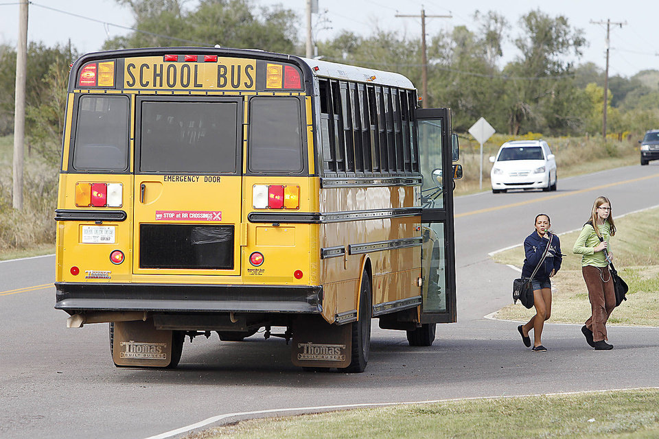 Deer Creek students get off the bus at Springer road and Rockwell in Oklahoma City, Wednesday October 10, 2012. Photo By Steve Gooch, The Oklahoman <strong>Steve Gooch - The Oklahoman</strong>