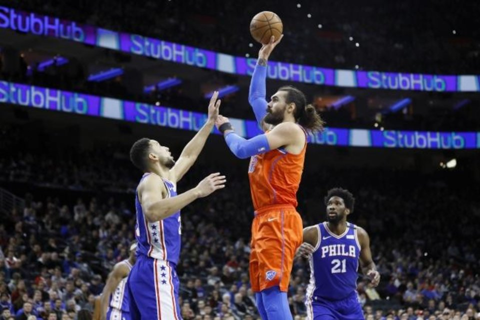 Photo -  Oklahoma City's Steven Adams, center, goes up to shoot against Philadelphia's Ben Simmons, left, during Monday night's game in Philadelphia. Adams had a season-high 24 points and 15 rebounds during the Thunder's 120-113 loss. [AP Photo/Matt Slocum]