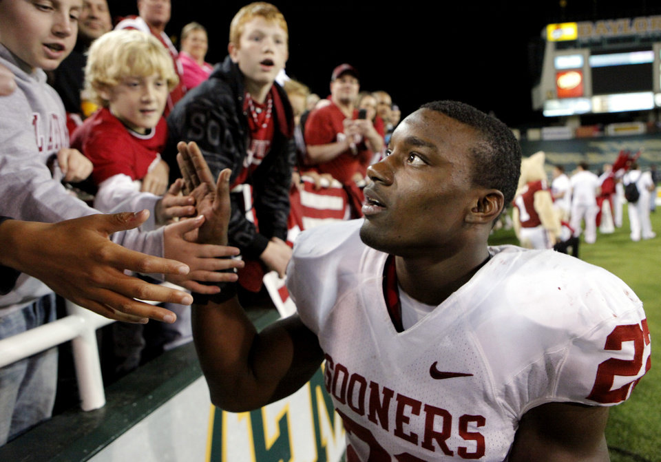 Photo - Roy Finch (22) greets fans following the college football game between the University of Oklahoma Sooners (OU) and the Baylor Bears (BU) at Floyd Casey Stadium on Saturday, November 20, 2010, in Waco, Texas.  Finch was injured in the fourth quarter and did not reenter the game.  Photo by Steve Sisney, The Oklahoman