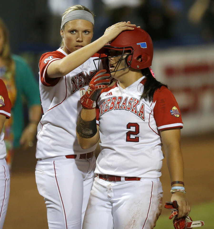 Nebraska's Courtney Breault, left, and Tatum Edwards react after their loss to Florida during the Women's College World Series softball game at ASA Hall of Fame Stadium in Oklahoma City, Saturday, June, 1, 2013. Photo by Bryan Terry, The Oklahoman