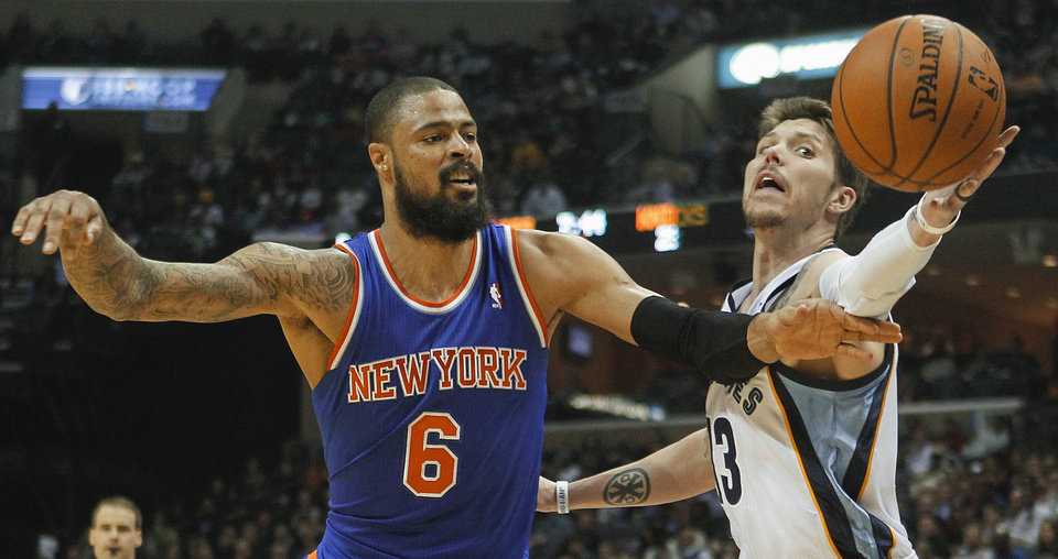 Photo - Memphis Grizzlies forward Mike Miller (13) reaches for a rebound against New York Knicks center Tyson Chandler (6) in the first half of an NBA basketball game, Tuesday, Feb. 18, 2014, in Memphis, Tenn. (AP Photo/Lance Murphey)