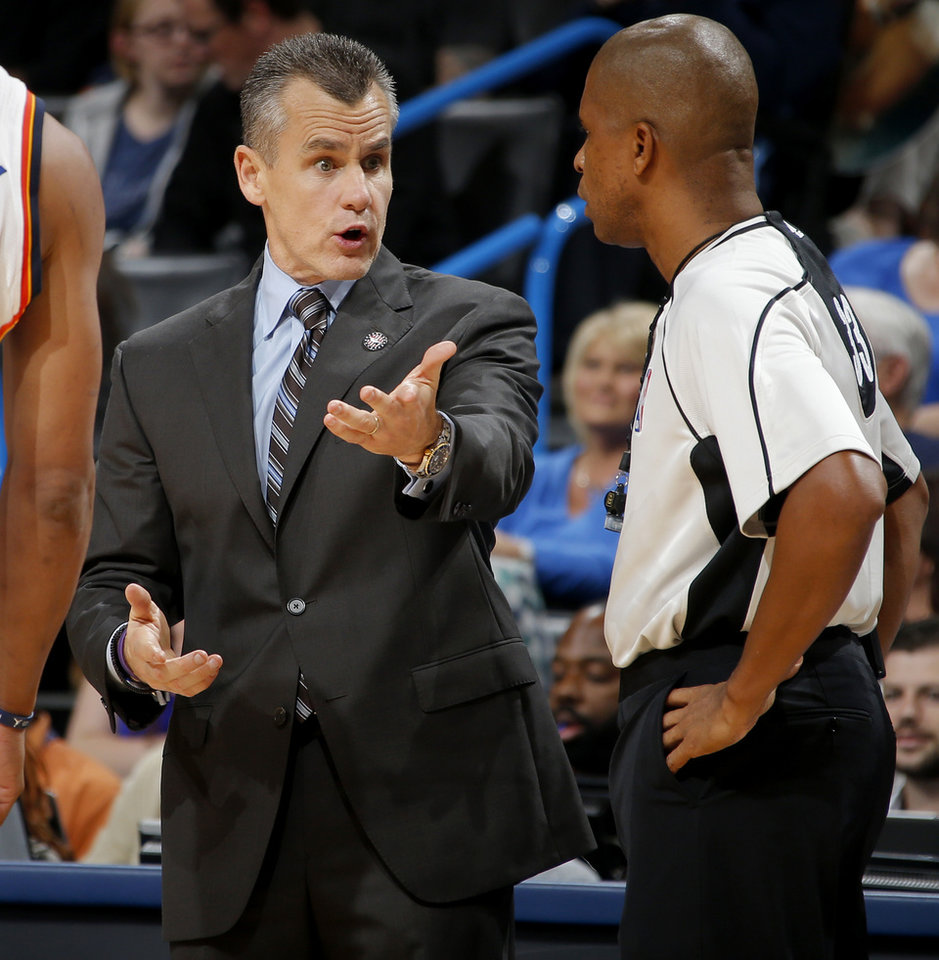 Photo - Oklahoma City coach Billy Donovan talks official Sean Corbin during an NBA basketball game between the Oklahoma City Thunder and the Toronto Raptors at Chesapeake Energy Arena on Wednesday, Nov. 4, 2015. The Thunder lost 103-98. Photo by Bryan Terry, The Oklahoman
