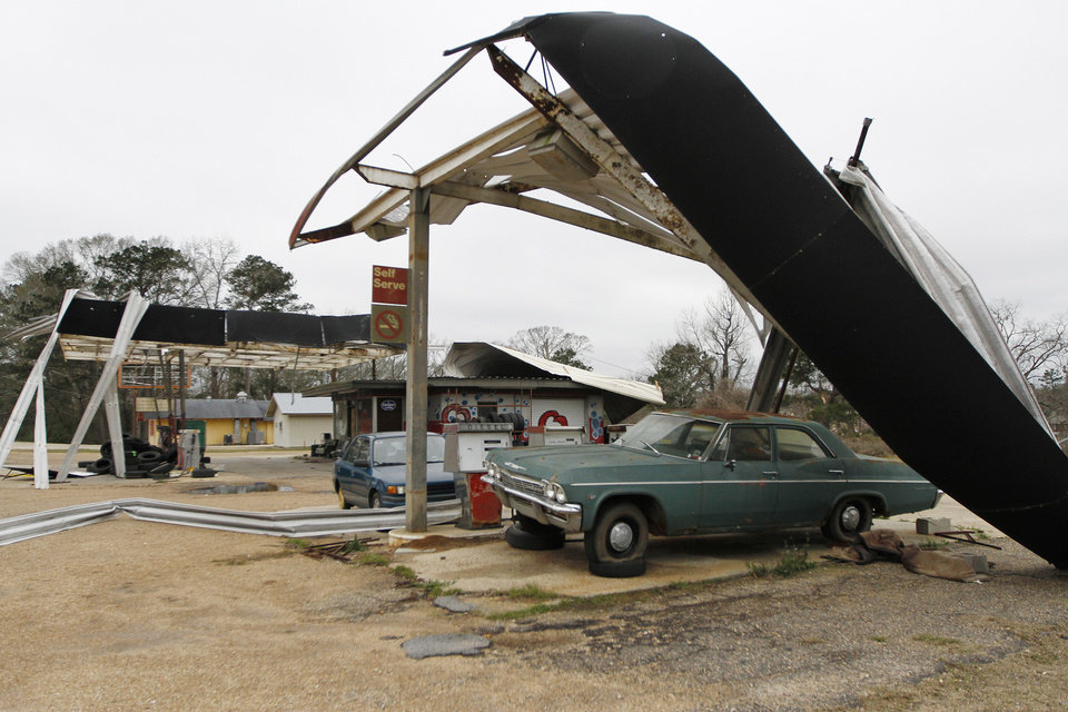 Photo - Large metal awnings sit ripped apart at Q's Car Wash in Centreville, Miss. on Wednesday, Dec. 26, 2012. More than 25 people were injured and at least 70 homes were damaged in Mississippi by the severe storms that pushed across the South on Christmas Day, authorities said Wednesday. (AP Photo/The Enterprise-Journal, Philip Hall)