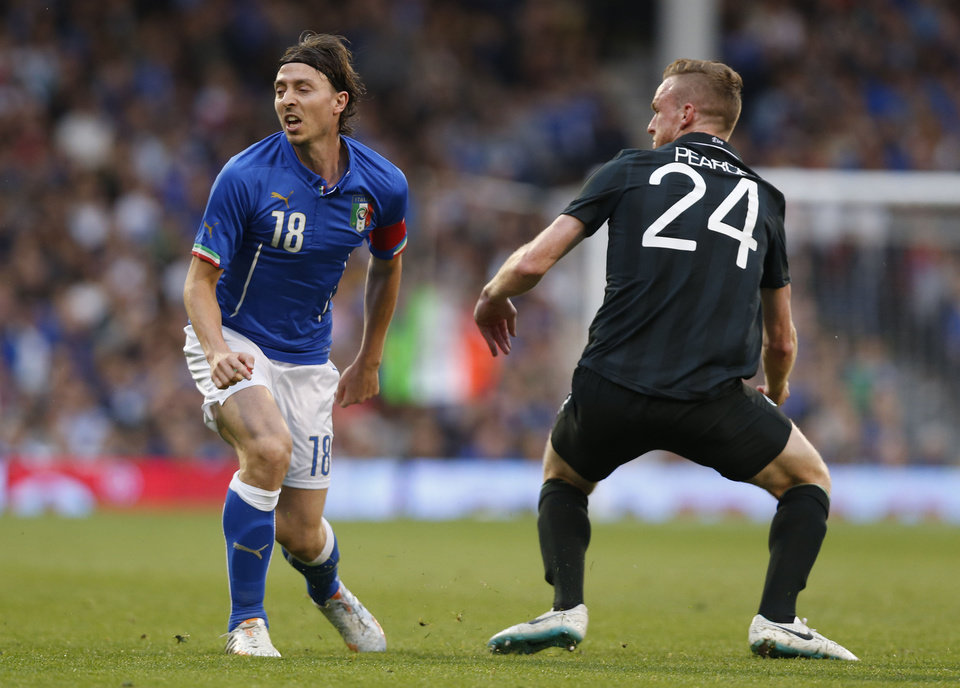 Photo - Italy's Riccardo Montolivo, left, is tackled by Republic of Ireland's Alex Pearce and is injured from the tackle during their international friendly soccer match at Craven Cottage, London, Saturday, May 31, 2014. (AP Photo/Sang Tan)