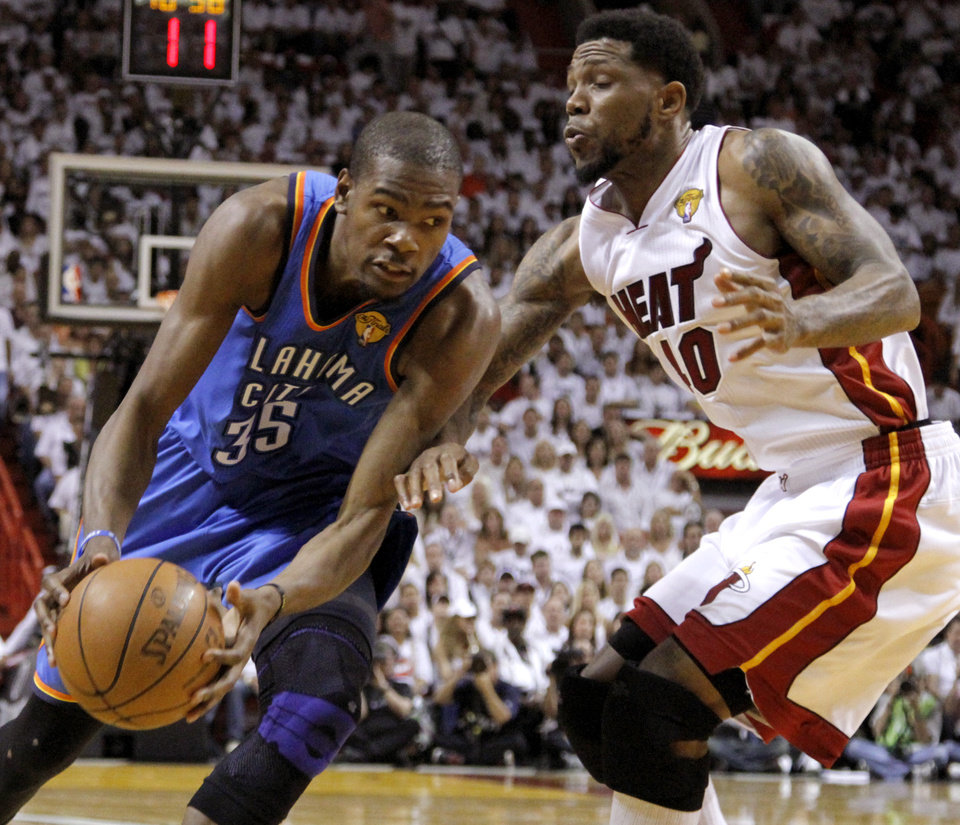 Photo - Oklahoma City's Kevin Durant (35) tries to get past Miami's Udonis Haslem (40) during Game 3 of the NBA Finals between the Oklahoma City Thunder and the Miami Heat at American Airlines Arena, Sunday, June 17, 2012. Photo by Bryan Terry, The Oklahoman
