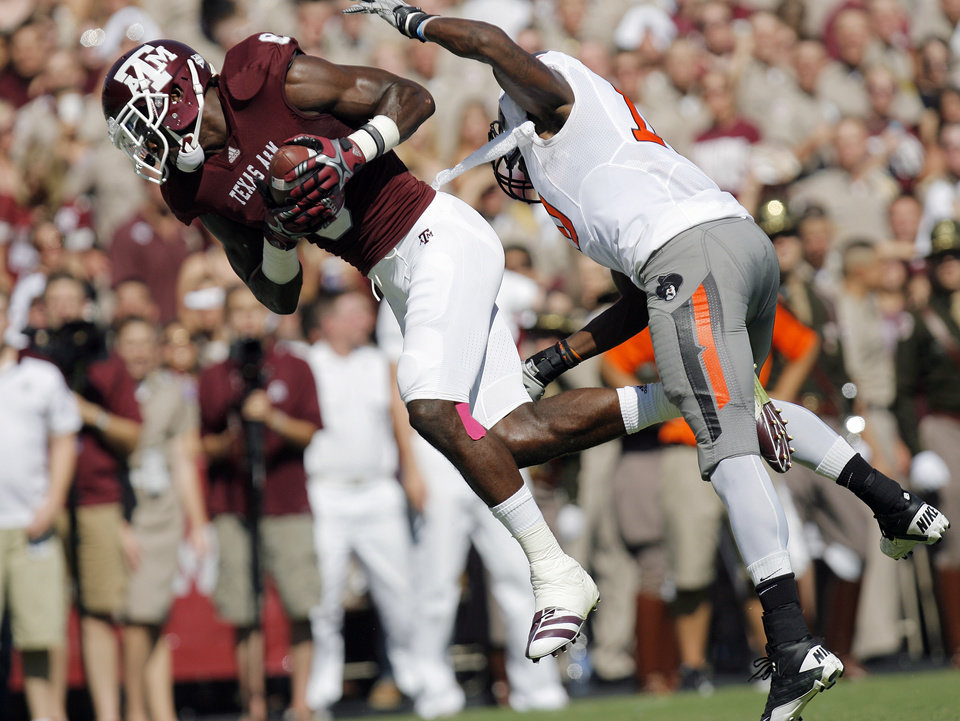 Jeff Fuller (8) of Texas A&M makes a touchdown catch in front of OSU\'s Markelle Martin (10) in the second quarter of their game Saturday in College Station, Texas. Photo by Nate Billings, The Oklahoman