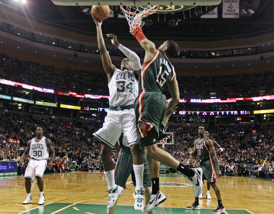 Boston Celtics small forward Paul Pierce (34) drives to the basket against Milwaukee Bucks forward Tobias Harris (15) during the first quarter of an NBA basketball game in Boston, Thursday, April 26, 2012. (AP Photo/Charles Krupa)