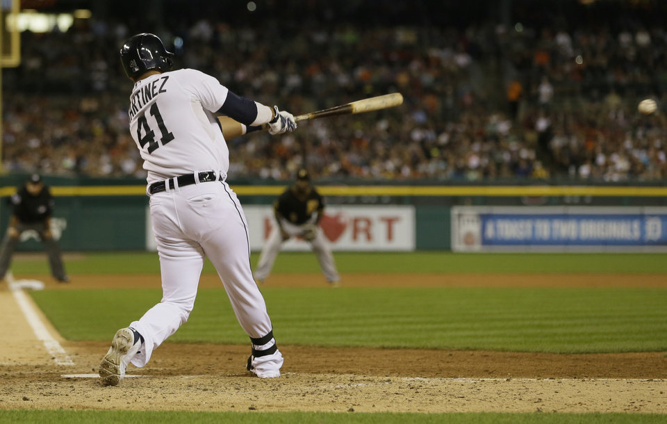 Photo - Detroit Tigers designated hitter Victor Martinez connects for a two-run single during the seventh inning of an interleague baseball game against the Pittsburgh Pirates, Wednesday, Aug. 13, 2014 in Detroit. (AP Photo/Carlos Osorio)