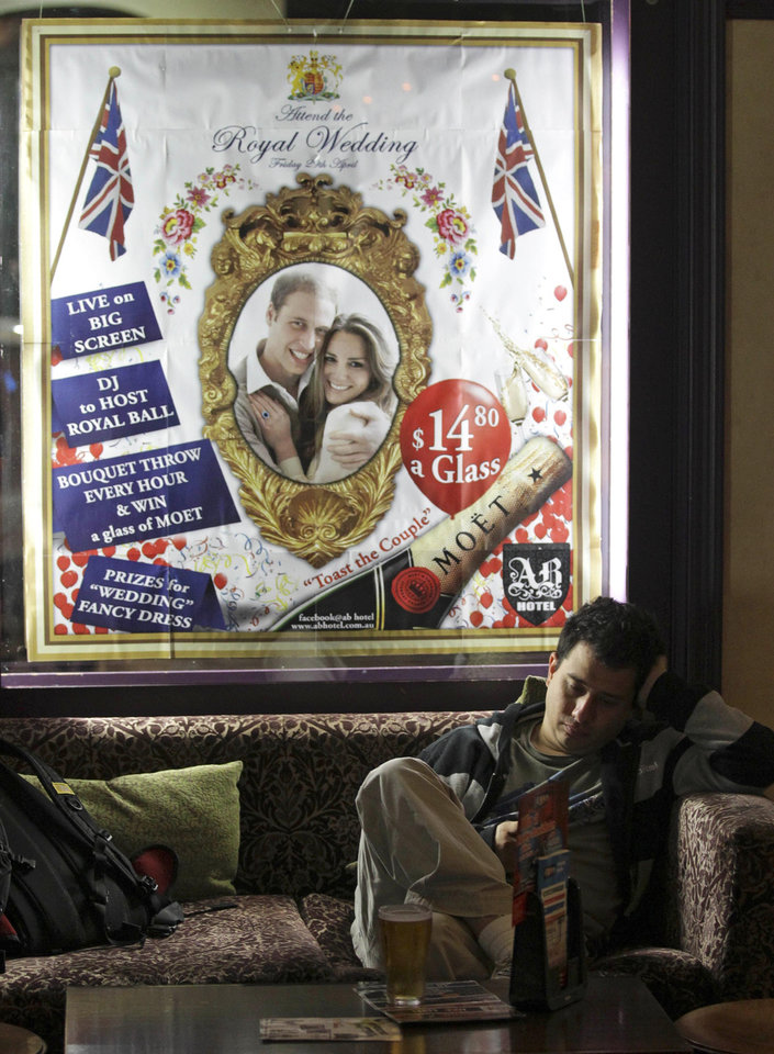 Photo - A man rests on a couch during a party at the Ancient Britain (the AB) hotel in Sydney, Australia, Friday, April 29, 2011. The hotel is hosting the party during celebrations for the wedding of Prince William and Kate Middleton. (AP Photo/Rob Griffith) ORG XMIT: SYD113