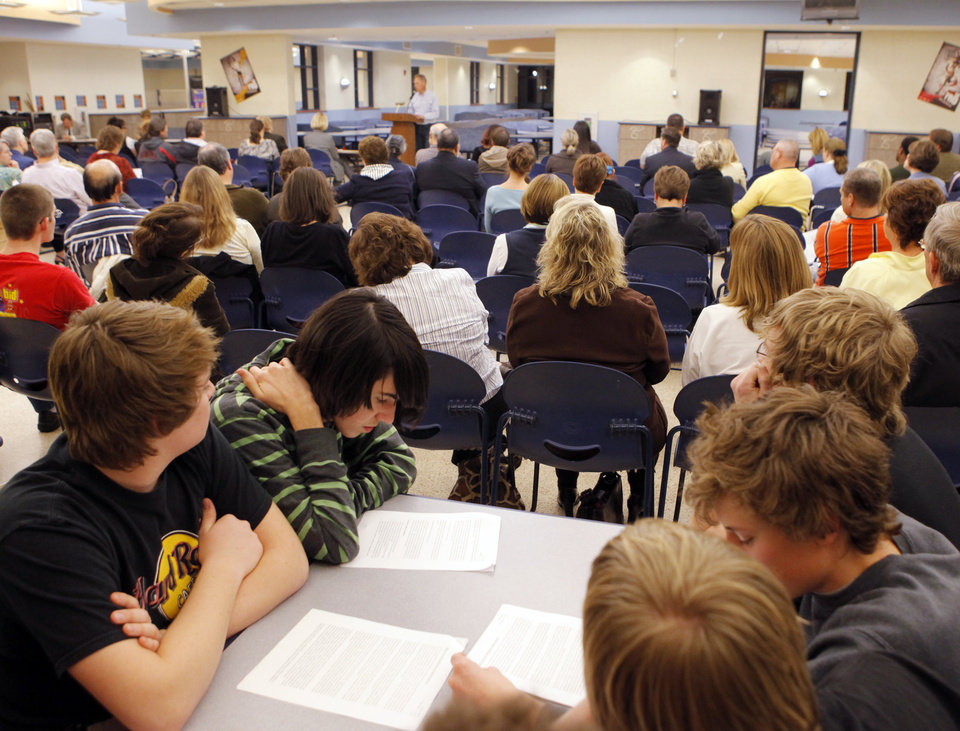 Parents, students and concerned citizens listen to a speaker during the Edmond Board of Education's Public Forum concerning the proposed new drug testing policy, at Edmond North High School in Edmond, Okla., February 9, 2009. BY NATE BILLINGS, THE OKLAHOMAN