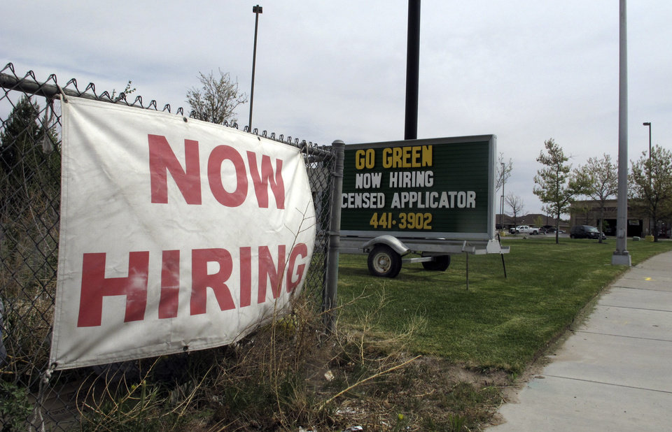 Photo - This April 9, 2014 photo shows employment signs inn the city of Hobbs, N.M., which are competing for workers to keep up with development in the midst of an oil boom. Virtually every business in town has a help wanted sign out.  (AP Photo/Jeri Clausing)
