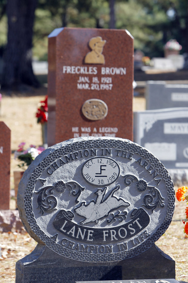 Photo - MOUNT OLIVET CEMETERY: Lane Frost and Freckles Brown's headstones in the Hugo cemetery, Friday , December 19, 2008. Photo by David McDaniel/The Oklahoman  ORG XMIT: KOD