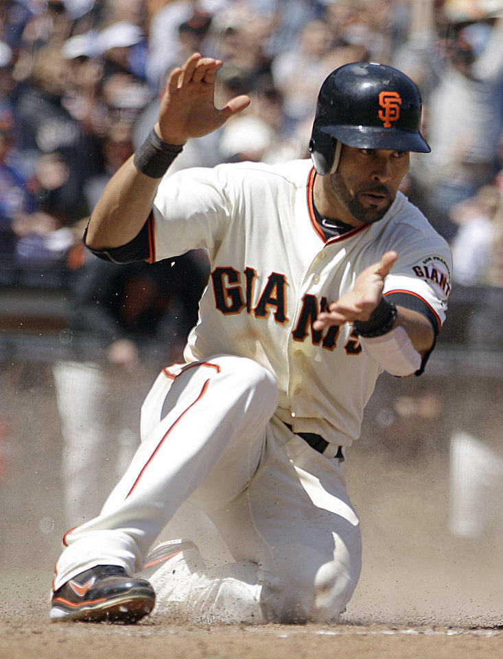 "FILE - In this May 17, 2012, file photo, San Francisco Giants' Angel Pagan celebrates after scoring against the St. Louis Cardinals during a baseball game in San Francisco. San Francisco and free-agent center fielder Pagan agreed to a $40 million, four-year contract Monday, Dec. 3, 2012, as the winter meetings got under way in Nashville, Tenn. Bobby Evans, the team's vice president of baseball operations, said the deal with Pagan was ""very close"" and the leadoff hitter would be subject to a physical to finalize his return to the reigning World Series champions. (AP Photo/Ben Margot, File)"