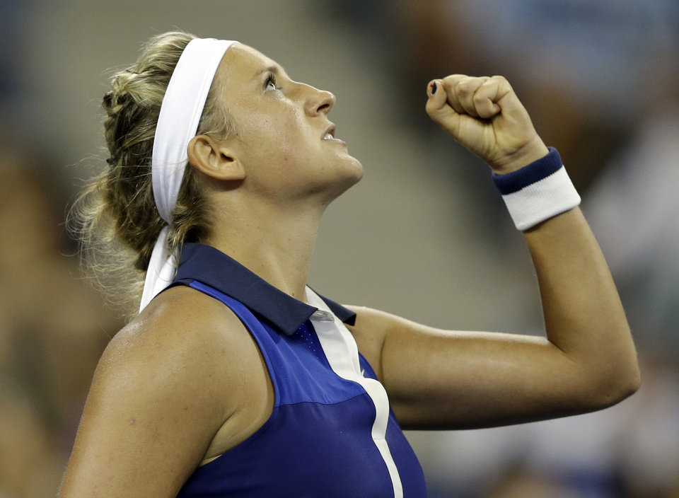 Photo - Victoria Azarenka,  of Belarus, reacts after a point during a math against Aleksandra Krunic, of Serbia, during the fourth round of the 2014 U.S. Open tennis tournament Monday, Sept. 1, 2014, in New York. (AP Photo/Darron Cummings)